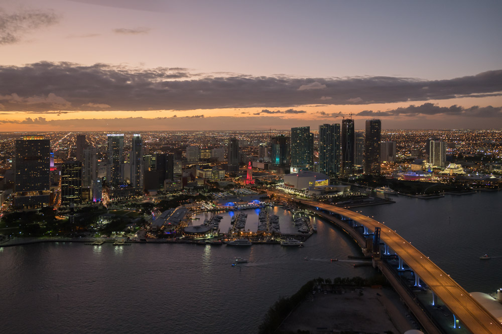 Aerial shot of Miami Skyline at sunset and Port Boulevard Bridge  from helicopter.