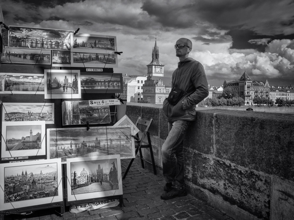 street art seller displaying his art for sale along Charles brigde in Prague, Czech Republic.