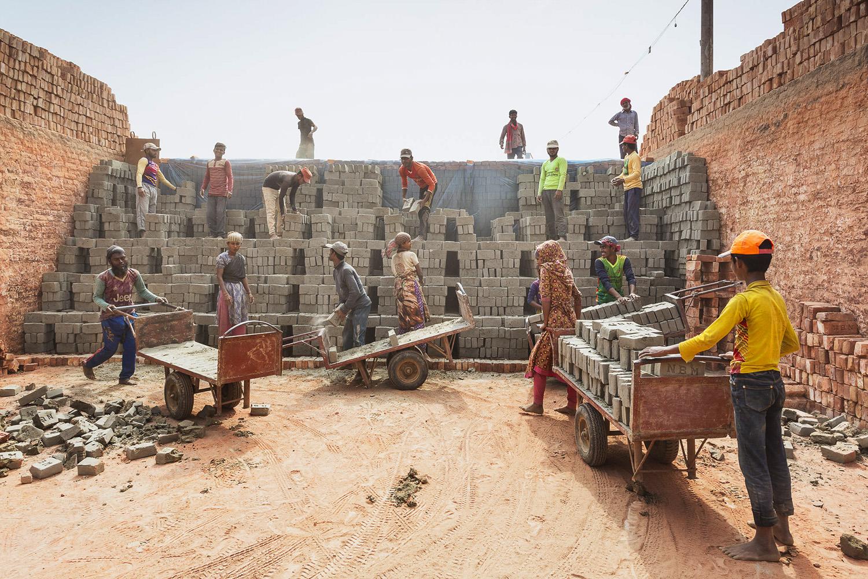 Teamwork and laughter at the Chittagong, Bangladesh brick facility.