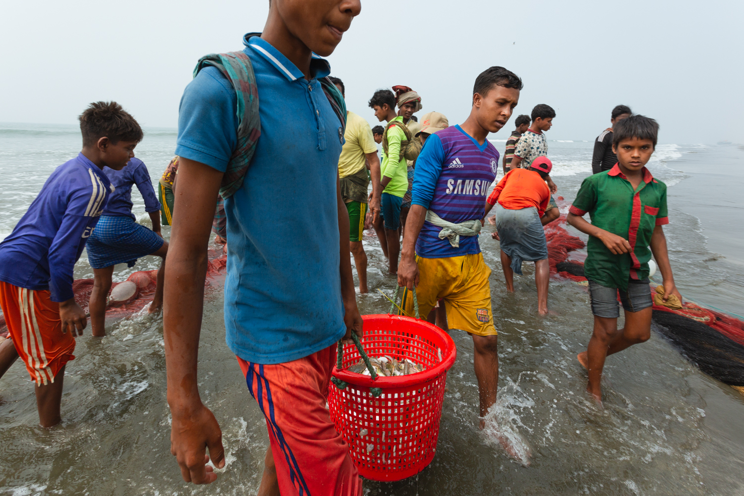 The workers of Bay of Bengal Cox's Bazar Bangladesh transporting caught fish