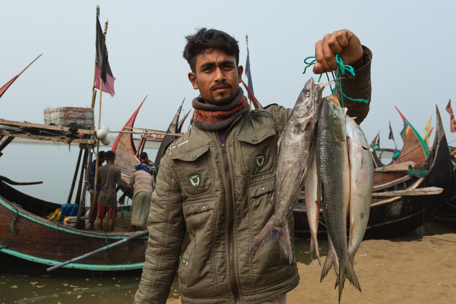 Young man with his prize catch at Bay of Bengal Cox's Bazar Bangladesh