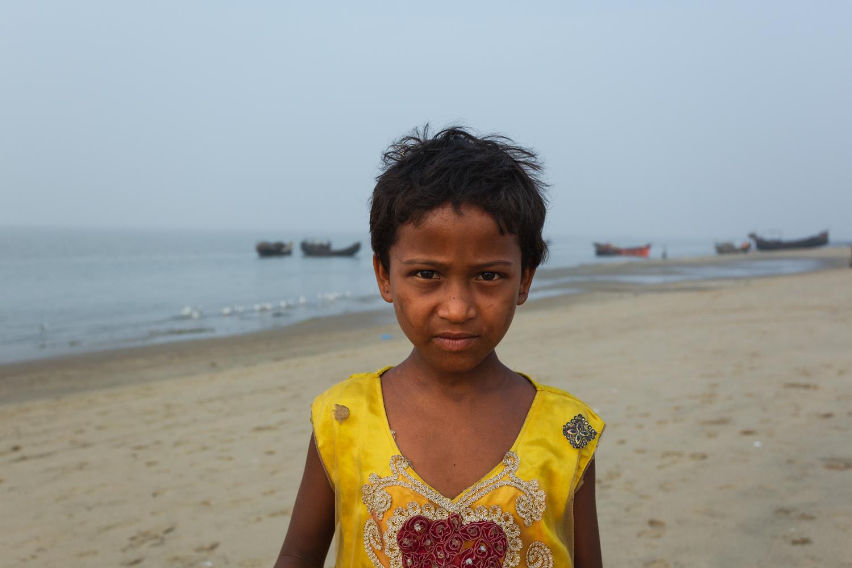 Coy young girl at Bay of Bengal Cox's Bazar Bangladesh poses for photograph