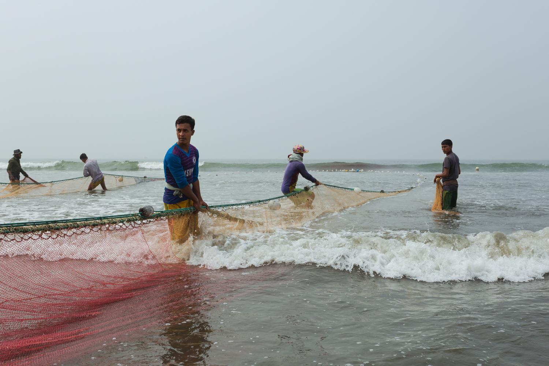 Men hauling nets at Cox's Bazar Fishing Village