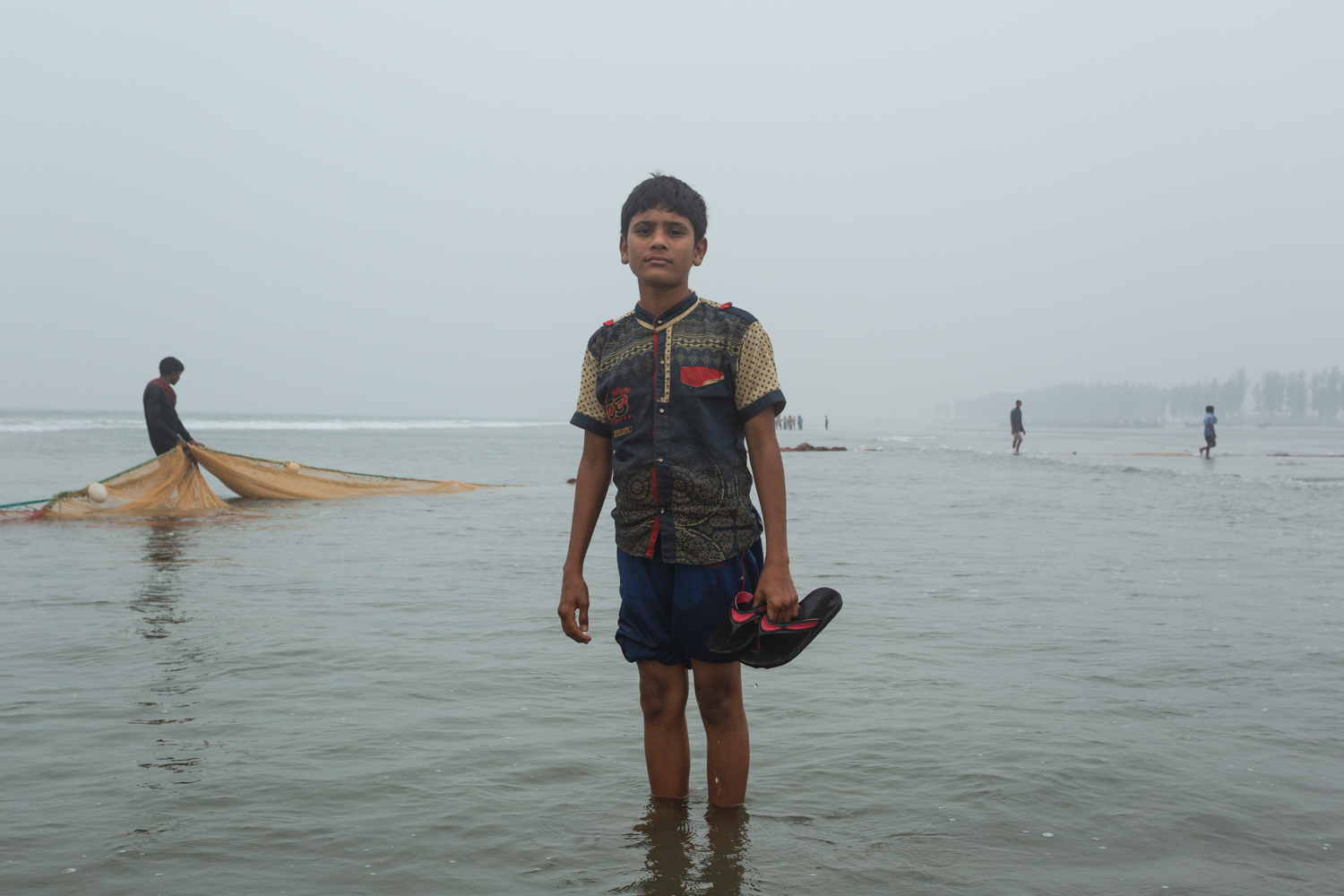 Young boy retiring for the day at Bay of Bengal, Cox's Bazar Bangladesh