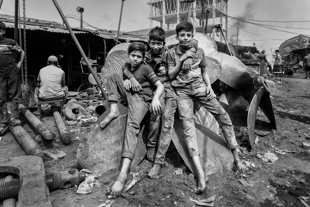 Child labourers work in hazardous conditions in a dockyard near the Buriganga River, without any safety shoes, helmets, gloves or masks.