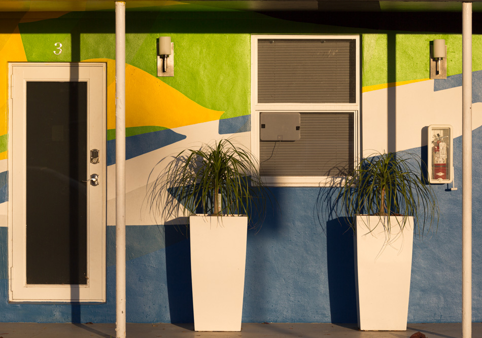 Urban landscape in Miami Florida, yellow green and blue facade, colourful facade in Wynwood Miami. Facade with primary and complementary colors of the spectrum