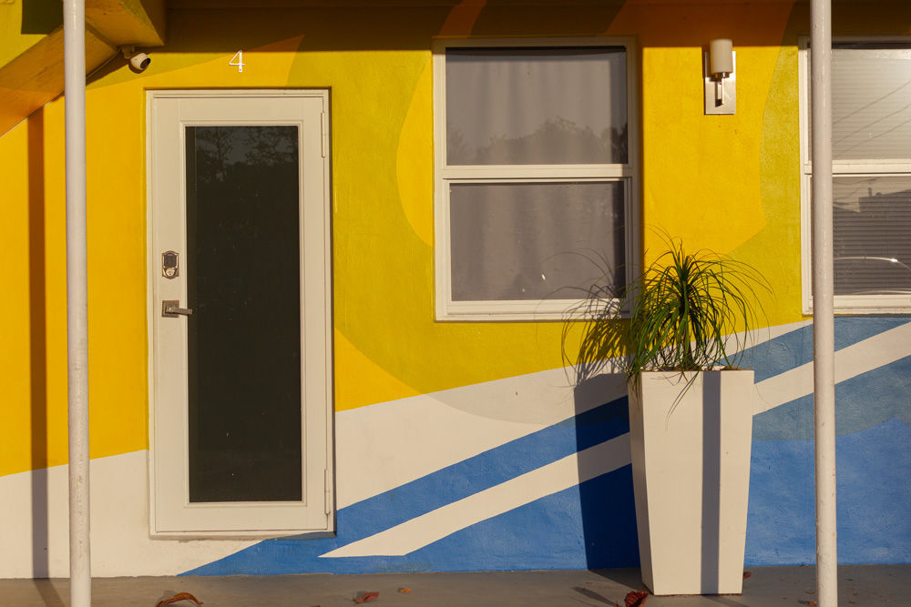 Urban landscape in Miami Florida, yellow and blue facade, colourful facade in Wynwood Miami. Facade with primary and complementary colors of the spectrum