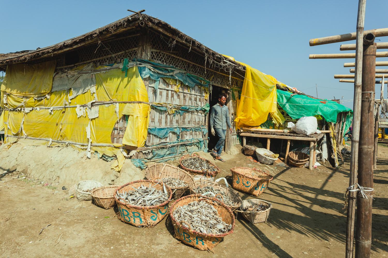 Facility at Dhaka - Bangladesh Dried Fish Village built from tarps and wood.