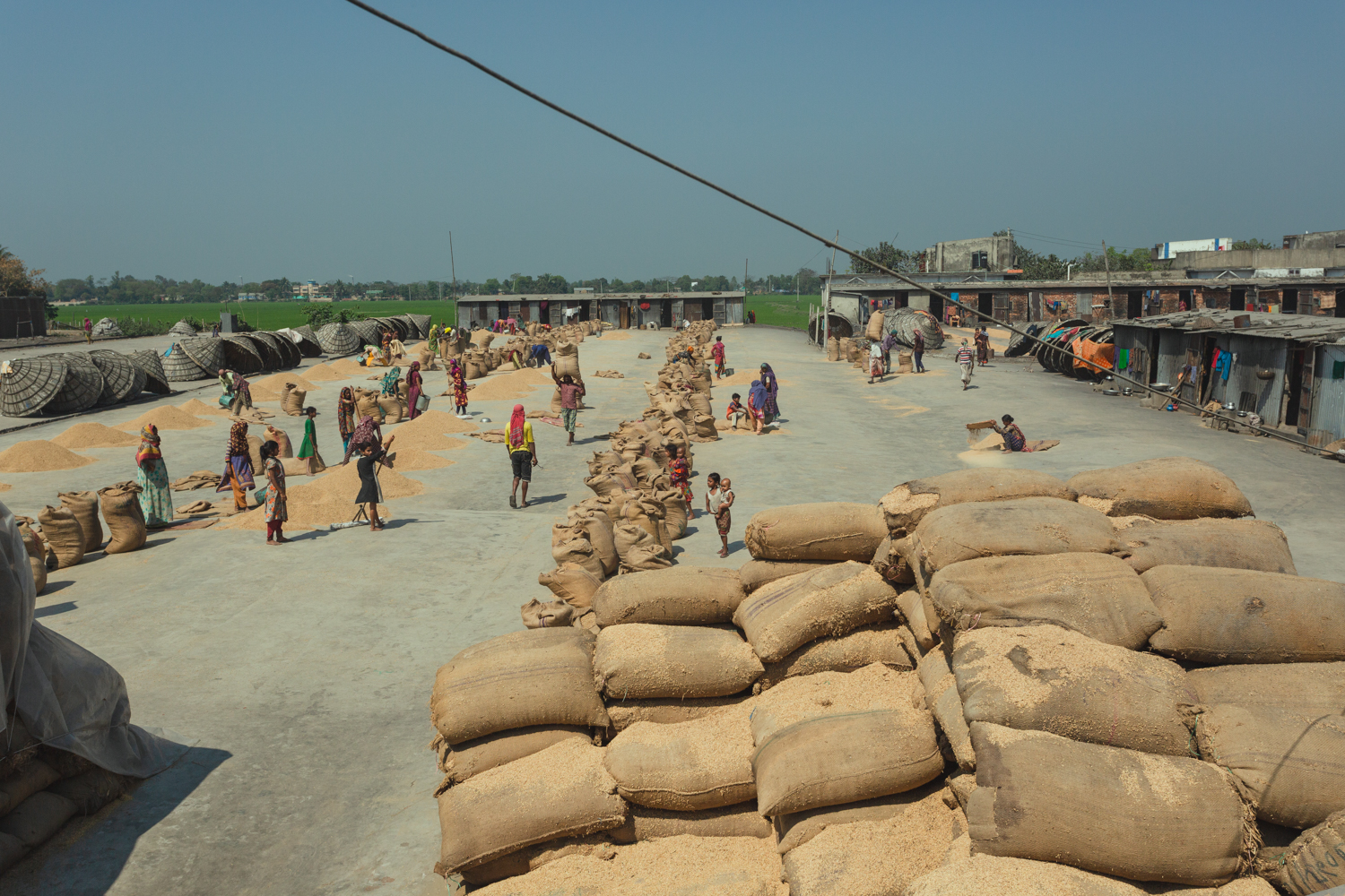 Families and workers gather at Rice Mills in Dhaka, Bangladesh.