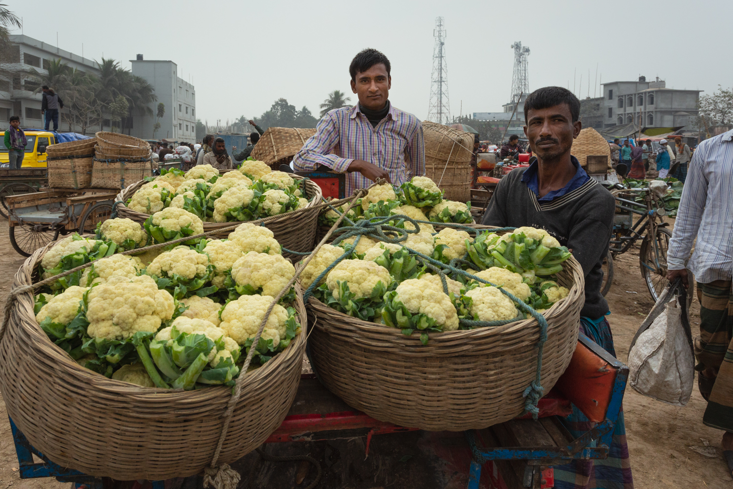 Sellers displaying their vegetables in baskets for sale at Dhaka, Bangladesh Vegetable Markets.